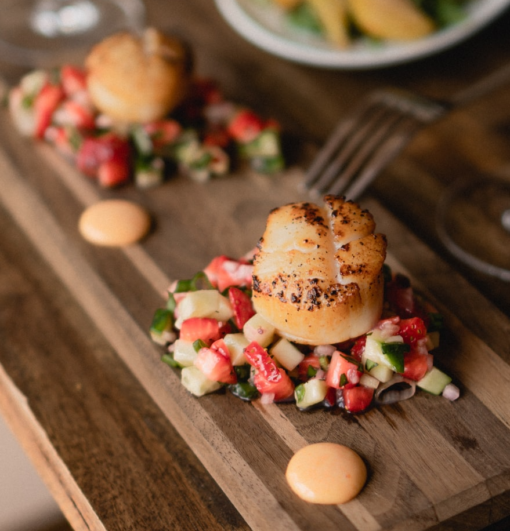 two scallops on plate