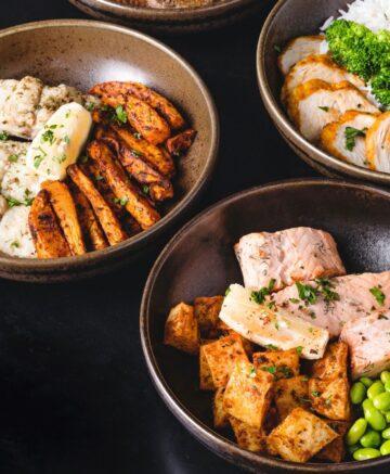 three bowls of seafood
